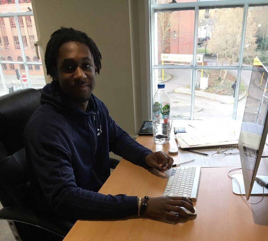 Daniel, Digital Designer, at work